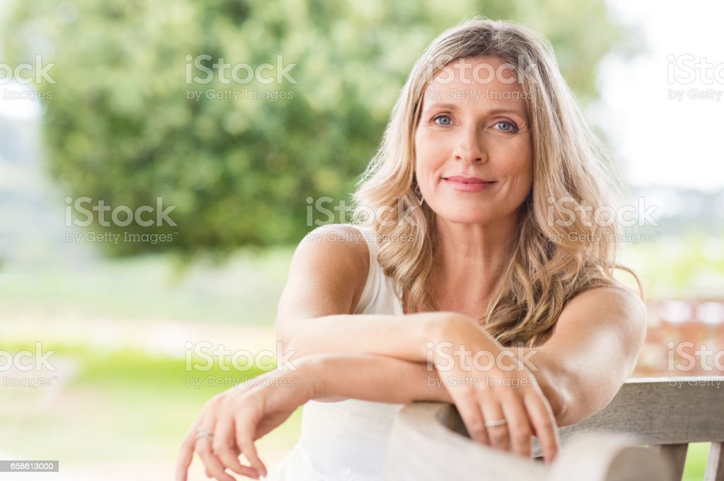 Senior woman relaxing stock photo