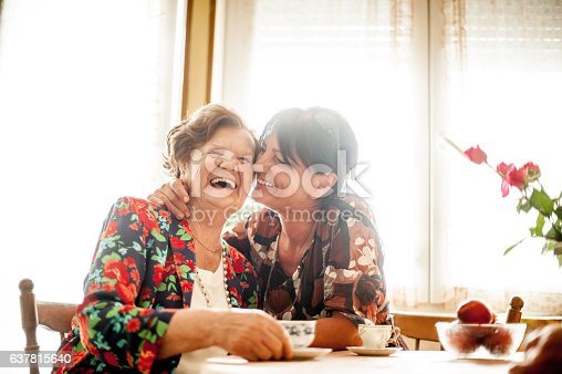 istock Senior Woman Relaxing with her Daughter at Home 637815640