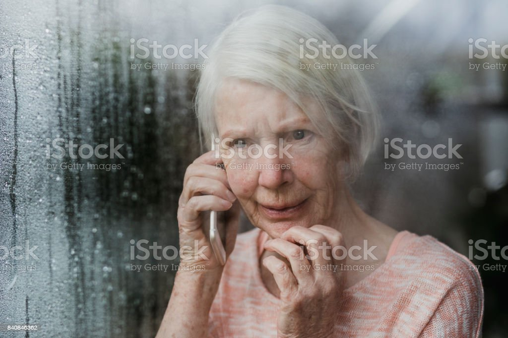 Senior Woman Reporting A Neighborhood Crime stock photo