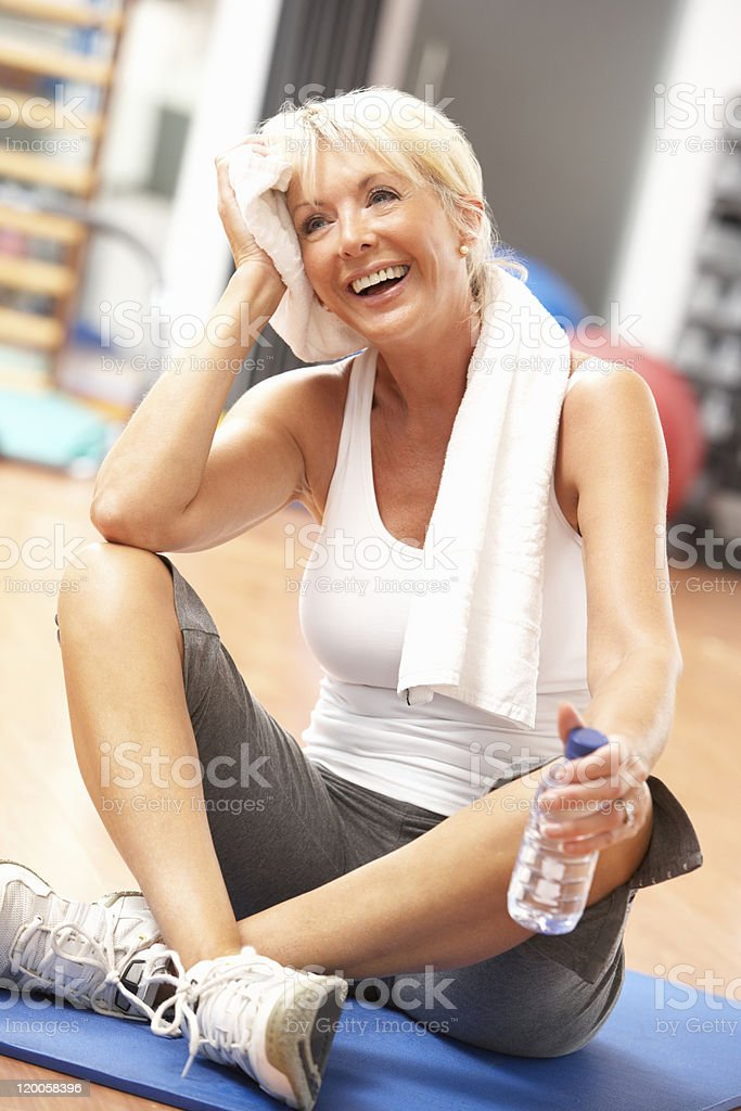 Senior Woman Resting After Exercises In Gym royalty-free stock photo