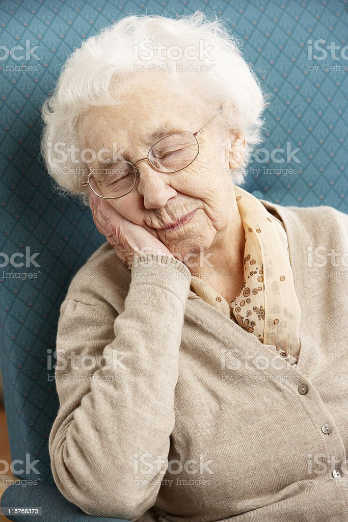 Senior Woman Resting In Chair royalty-free stock photo