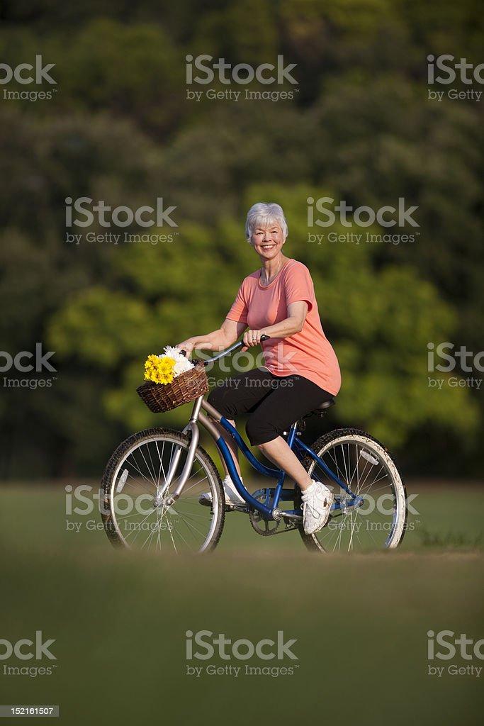 Senior Woman Riding Bicycle In Texas royalty-free stock photo