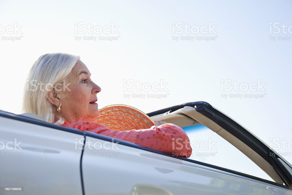 Senior woman riding in convertible royalty-free stock photo