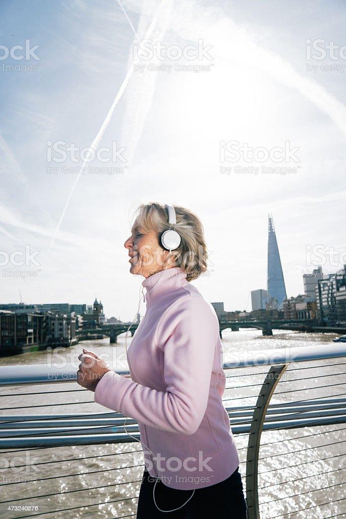 Senior Woman Running In London Downtown stock photo