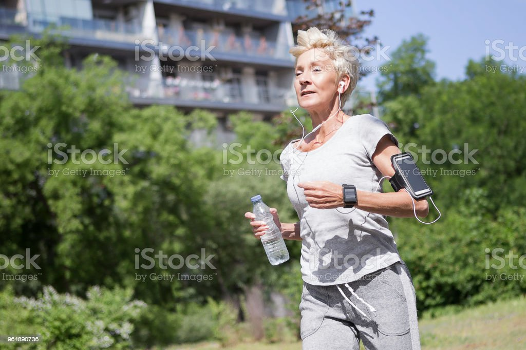 Senior woman running royalty-free stock photo