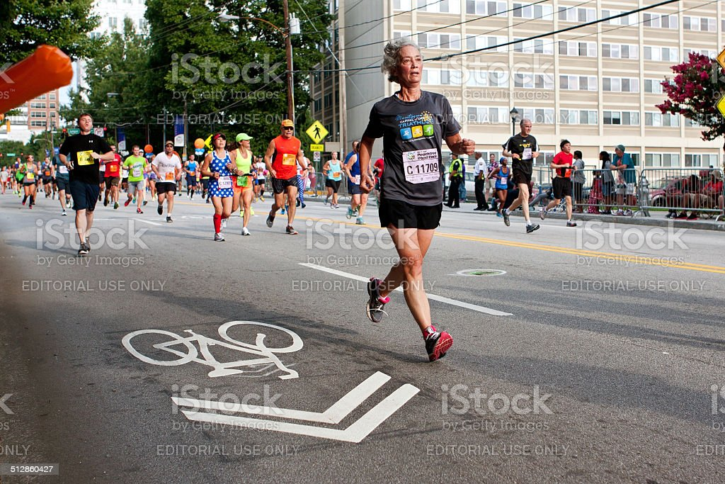 Senior Woman Runs In Atlanta Peachtree Road Race stock photo