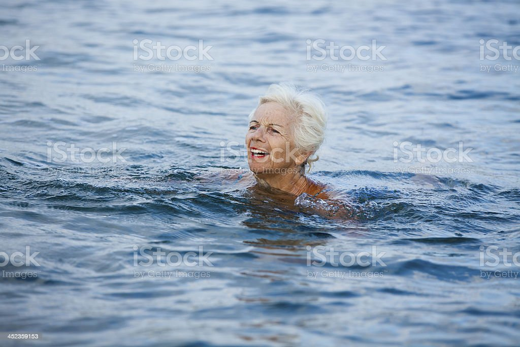 Senior woman screaming for help royalty-free stock photo