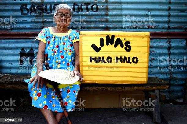 Senior woman sells mixed sweets with shaved ice called halo halo picture id1136581244?b=1&k=6&m=1136581244&s=612x612&h=yr6eeo2nh6e9vptoyygu2ucps05aq7uwfqpvdvw0 ea=