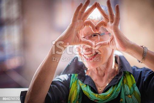 istock Senior woman sending love 894074170
