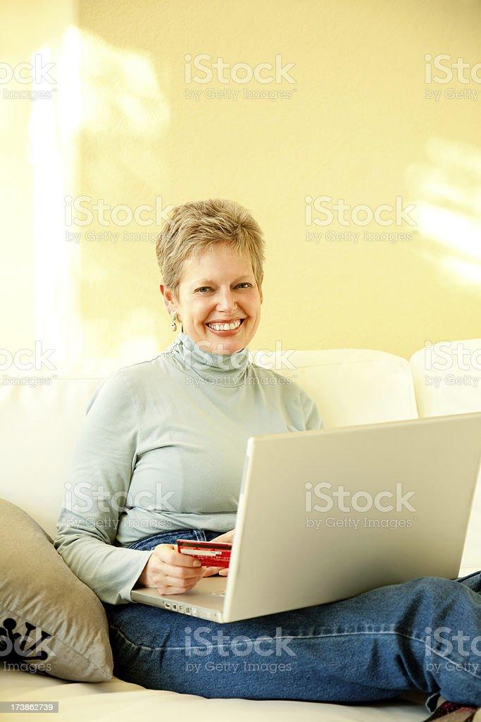 Senior Woman Shopping Online at Her Laptop royalty-free stock photo