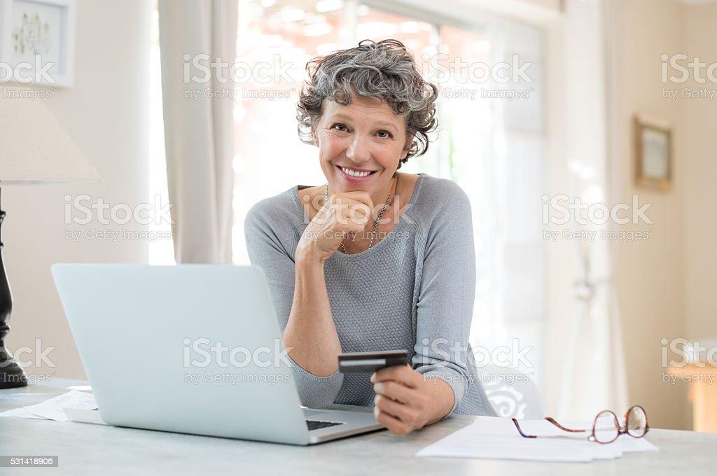 Senior woman shopping online stock photo