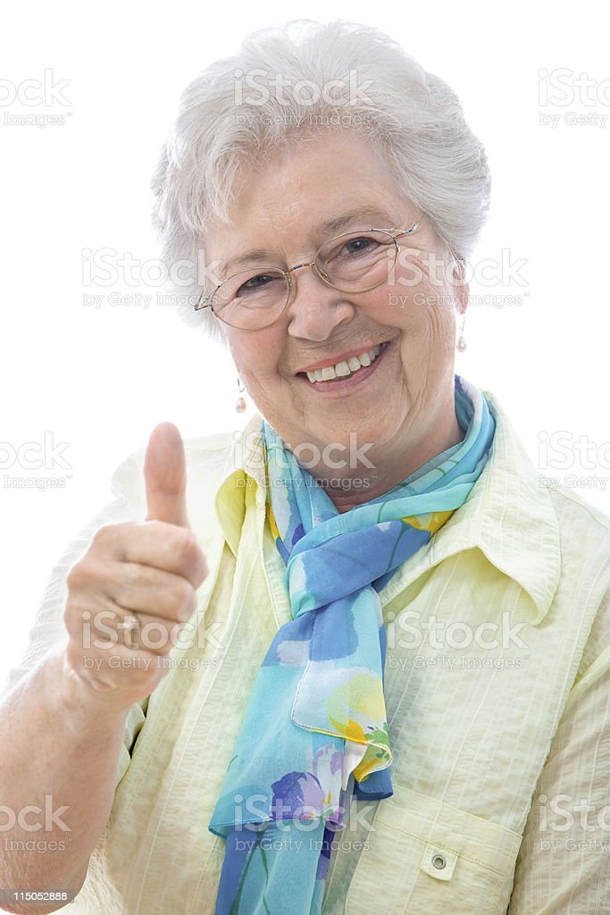 senior woman showing thumbs up sign royalty-free stock photo