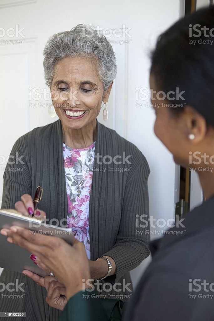 Senior woman signs a Petition stock photo