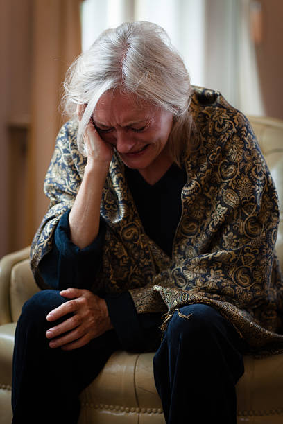 Old woman sitting on a log stock image. Image of pensioner
