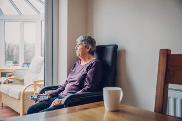Senior Woman Sitting Alone stock photo