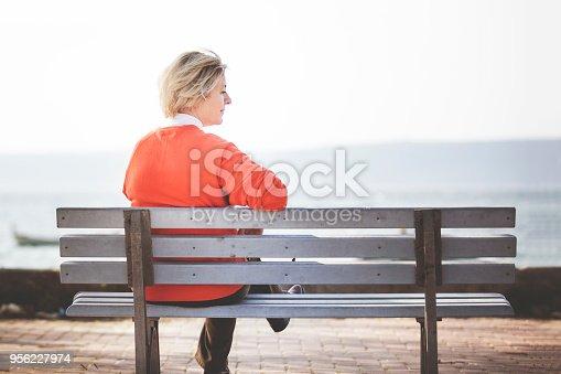 istock Senior woman sitting alone 956227974