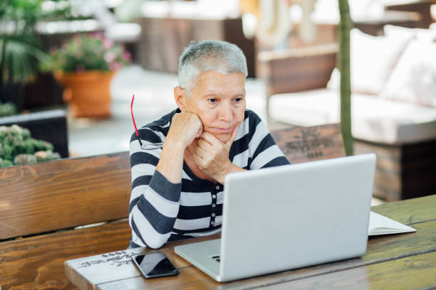 Senior Woman sitting in a cafe stock photo