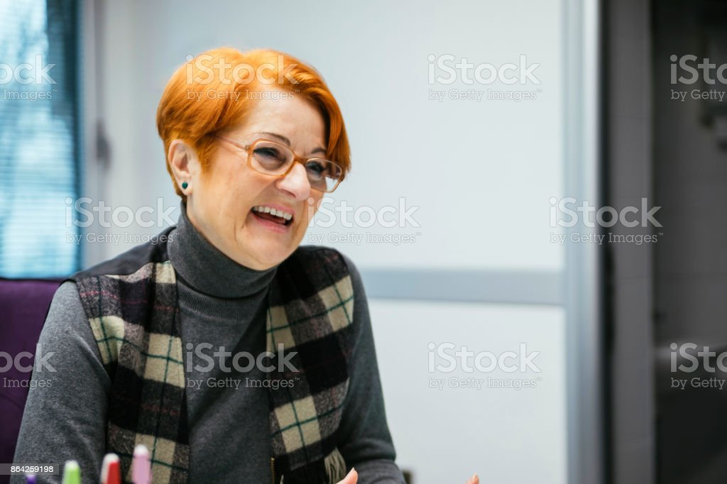 Senior Woman Sitting In A Chair royalty-free stock photo