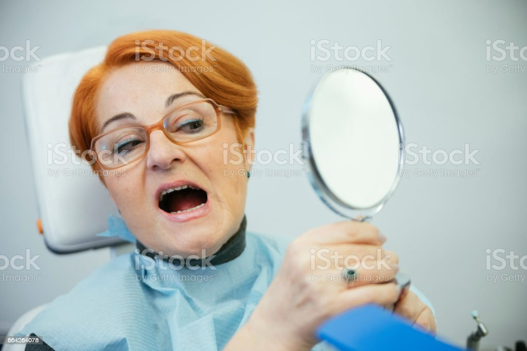 Senior Woman Sitting In A Dentists Chair royalty-free stock photo
