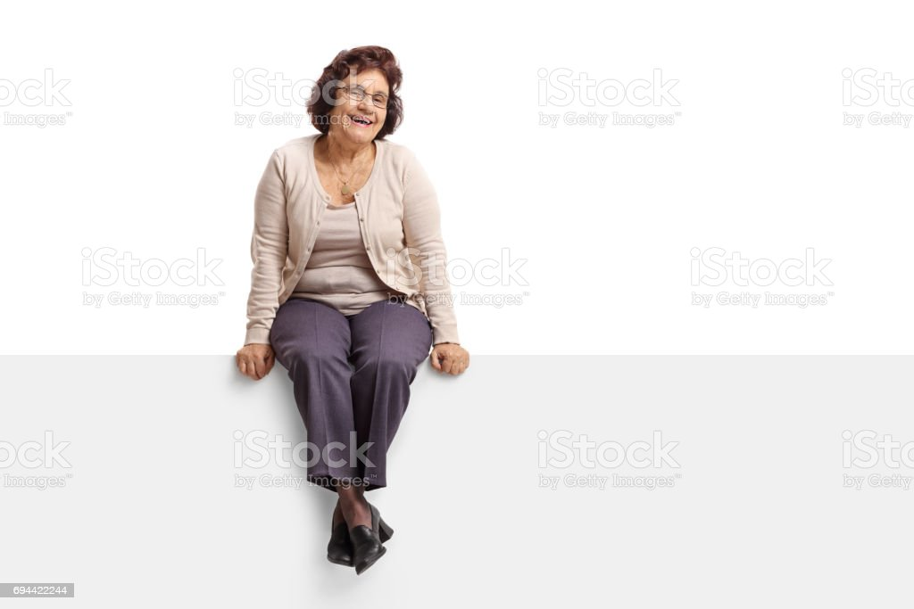 Senior woman sitting on a panel stock photo