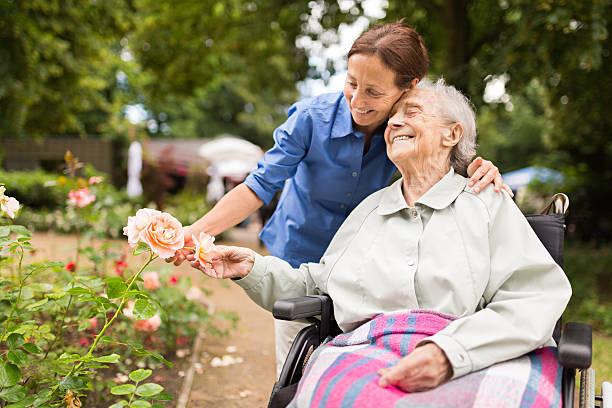 Senior woman sitting on a wheelchair with caregiver picture id543455614?b=1&k=6&m=543455614&s=612x612&w=0&h=kovhg32som1xie3rmrsn6sbnz9jjeezbtbiyvf1csie=