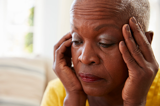 874789168 istock photo Senior Woman Sitting On Sofa At Home Suffering From Depression 874789102
