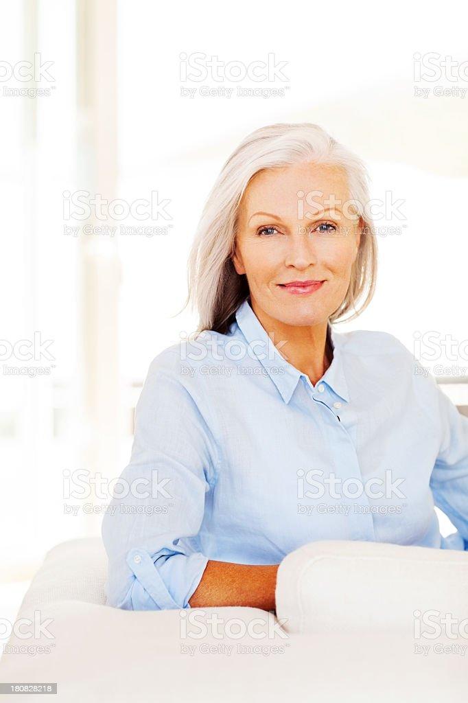 Senior Woman Sitting On Sofa stock photo