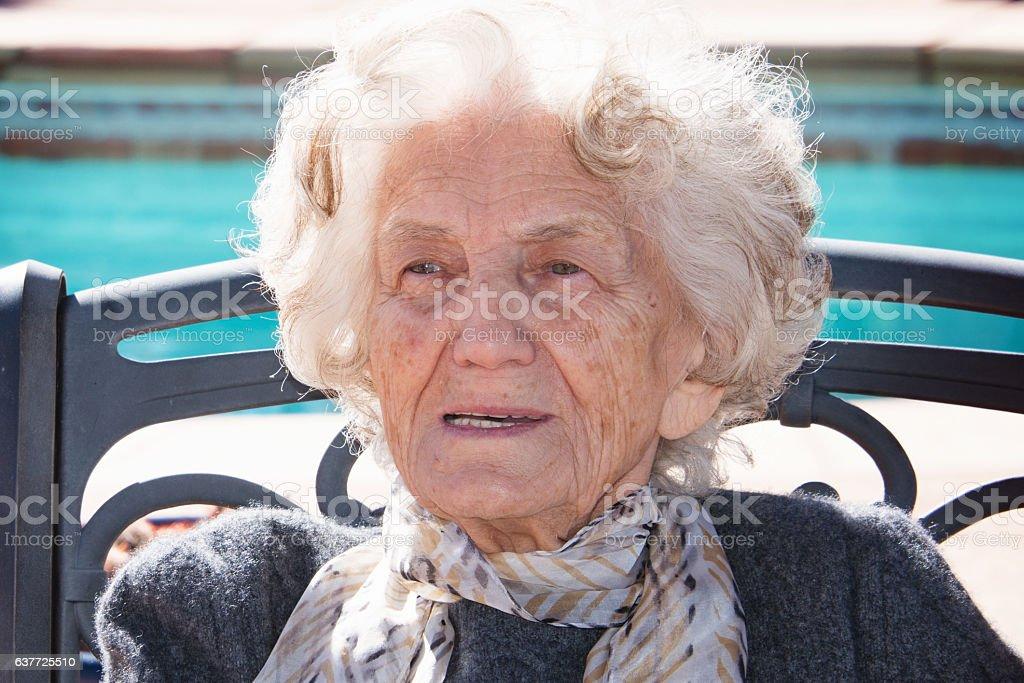 Senior Woman Sitting Outdoors, Dreamy Look stock photo