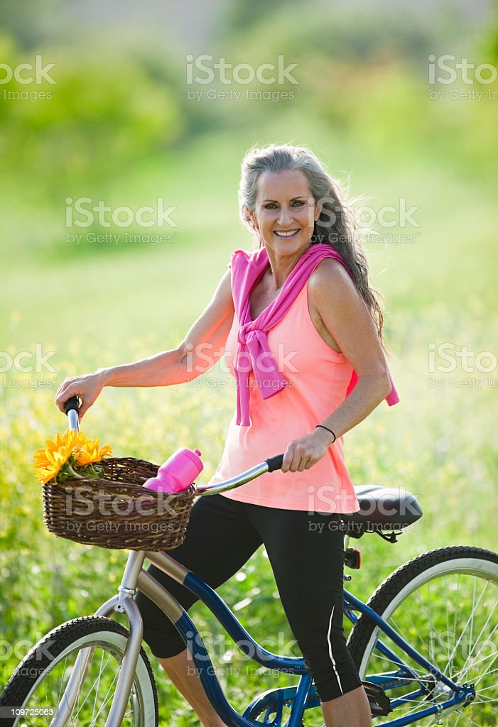 Senior Woman Sitting Outdoors On Bicycle royalty-free stock photo