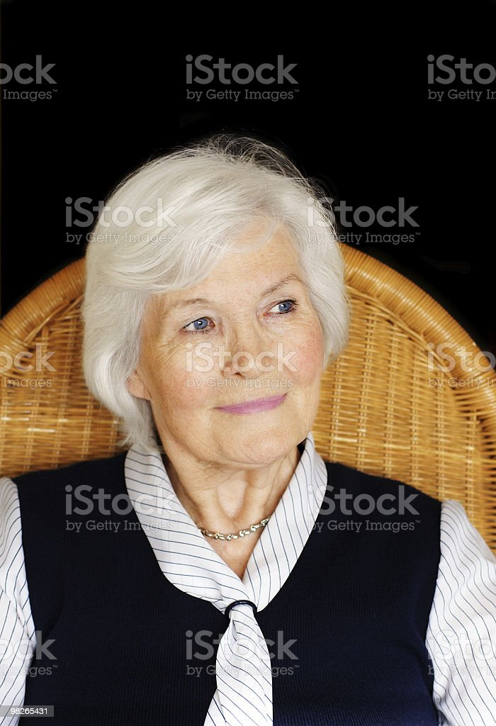 Senior woman sitting royalty-free stock photo