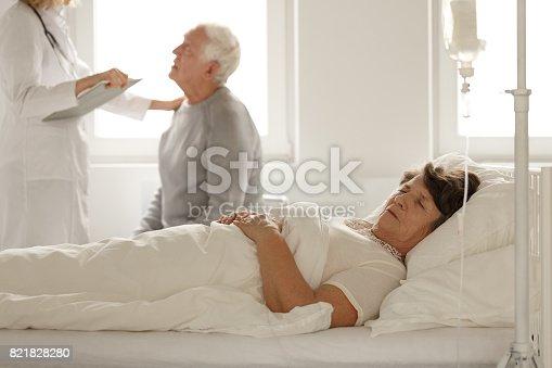 909569706 istock photo Senior woman sleeping in hospital bed 821828280
