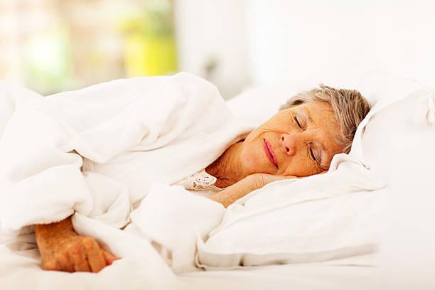 senior woman sleeping stock photo