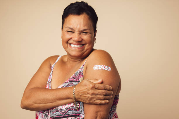 Senior woman smiling after vaccination stock photo