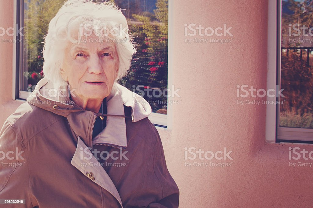 Senior Woman Smiling Outdoors, Toned Image foto royalty-free