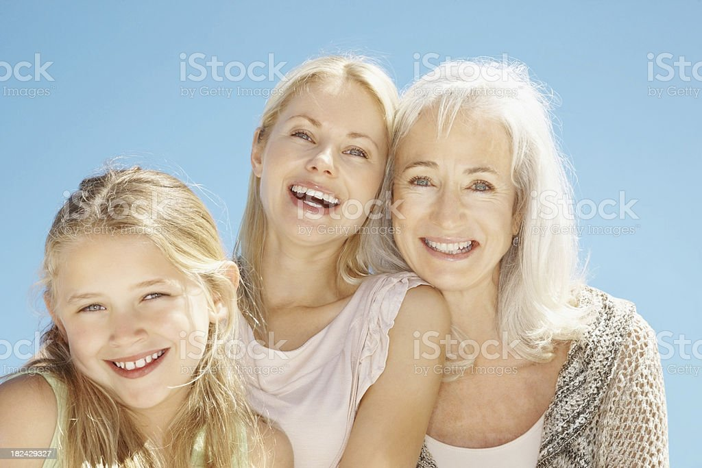 Senior woman smiling with her granddaughter and daughter royalty-free stock photo