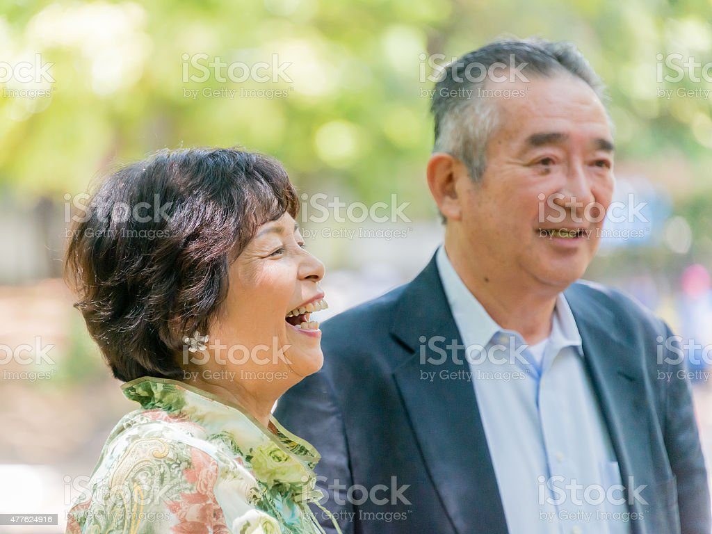 Senior woman smiling with her husband stock photo