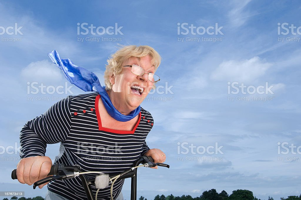 Senior Woman Speeding on a Bike royalty-free stock photo