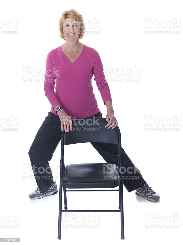 Senior woman stretch exercise with chair stock photo