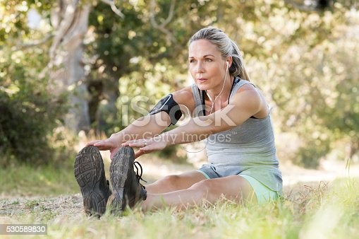 istock Senior woman stretching 530589830