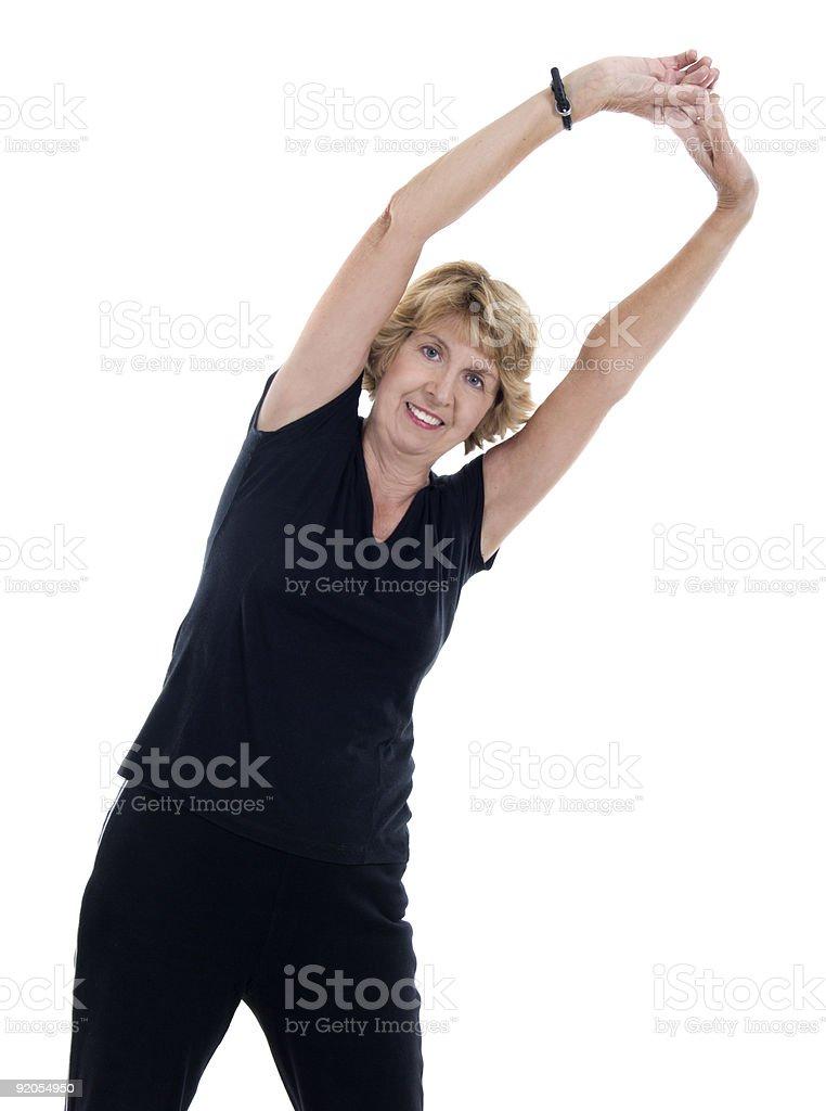 Senior woman stretching royalty-free stock photo