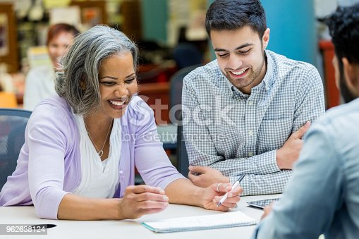 istock Senior woman studies with university classmates 962638124