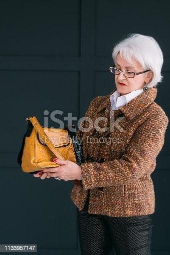 1133515238 istock photo senior woman style trendy wardrobe tweed elegance 1133957147