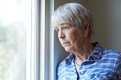 istock Senior Woman Suffering From Depression Looking Out Of Window 647711746