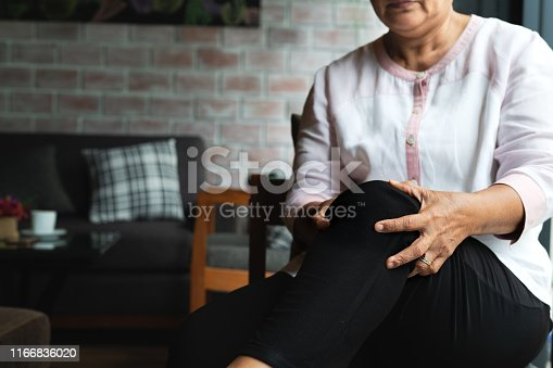 698466046 istock photo senior woman suffering from knee pain at home, health problem concept 1166836020