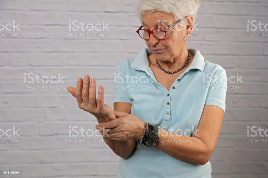 Senior Woman suffering from Wrist Pain , arthritis stock photo