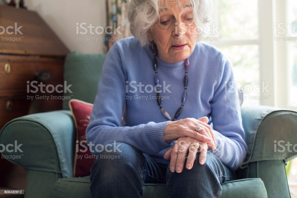 Senior Woman Suffering With Parkinsons Diesease stock photo