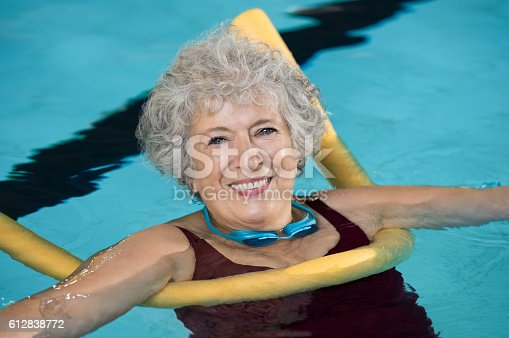 612839448istockphoto Senior woman swim 612838772
