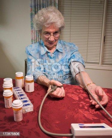 istock senior woman taking blood pressure 172875806