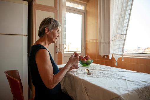 Senior woman taking dose medication