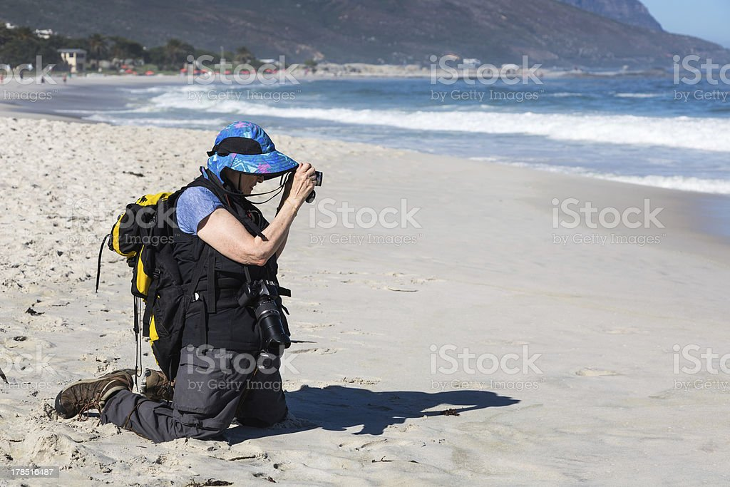 Senior Woman Taking Photographs on Vacation stock photo